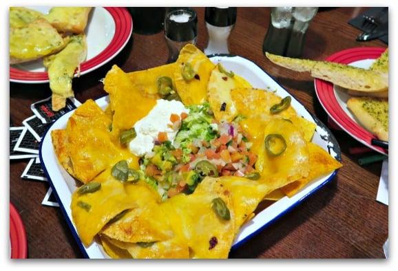 Sharing nachos at TGI Fridays