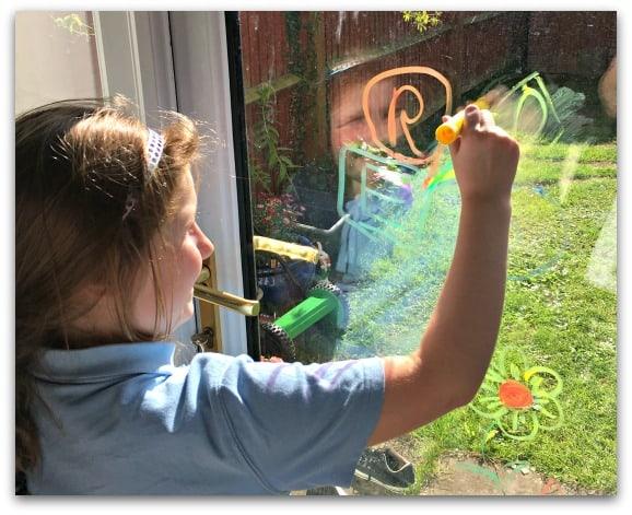 Window artist with Little Brian Paint Sticks