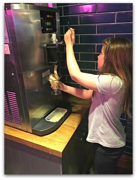Old White Horse Stourbridge Helping herself to ice cream for her Bottomless Ice Cream Sundae
