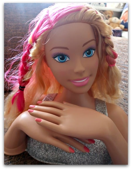 Practising hair styles with Barbie Flip and Reveal Deluxe Styling Head