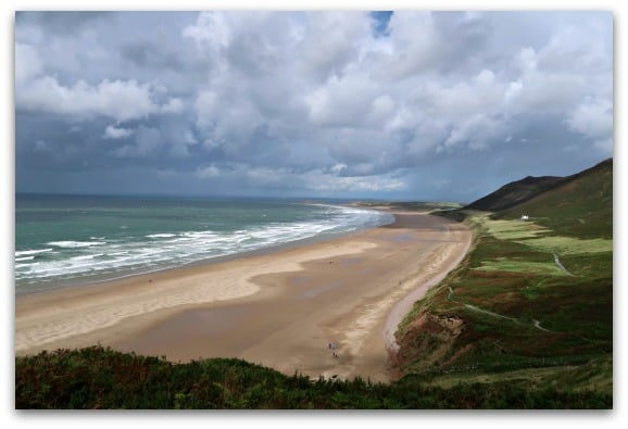 The beautiful, unspoilt beach of Rhossili Bay in South Wales