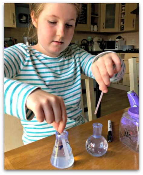 Young scientist at work with the Project Mc2 Ultimate Lab Kit